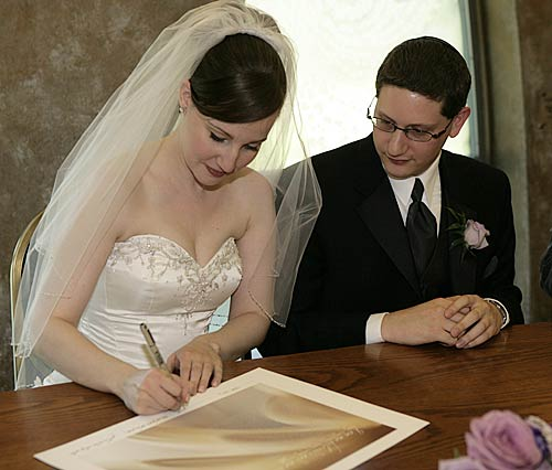Nicole and Jonathan signing their ketubah, designed by Daniel Sroka www.modernketubah.com.