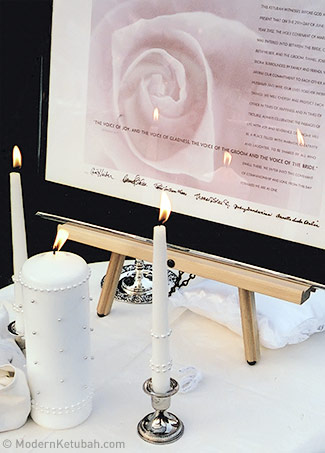 This is my own ketubah during my wedding, framed next to the unity candles.